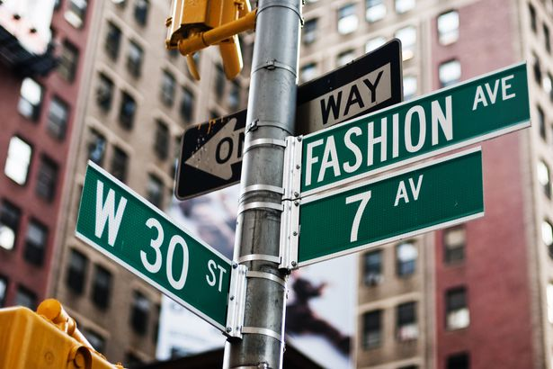 street signs of Fashion Avenue and W 30th in NYC