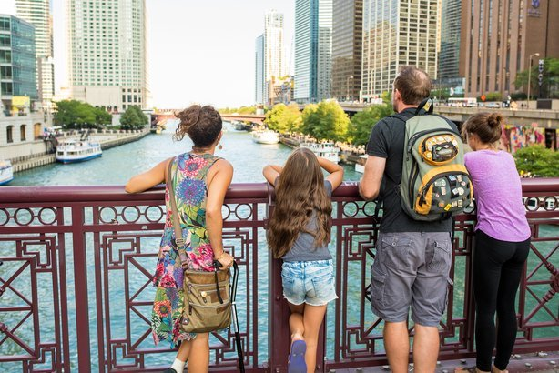 young family looks out over the Chicago River