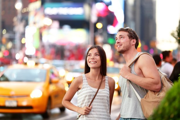 two tourists in Times Square, New York City
