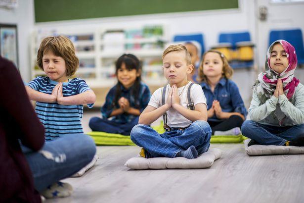 children meditating at school