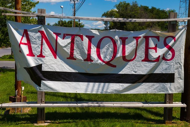 antiques banner sign along road