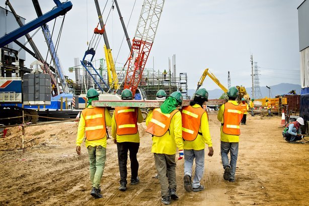 Shot of construction workers walking away on a construction site
