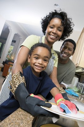 African American family washing dishes