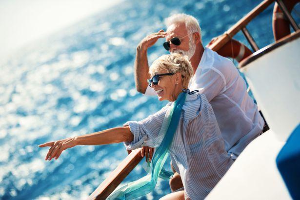 senior couple on a sailing cruise
