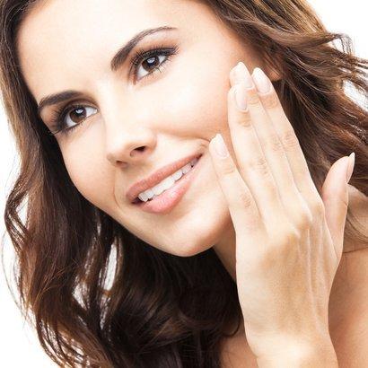 beautiful young woman touching skin