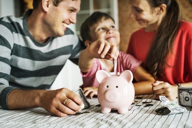 family with money and piggy bank