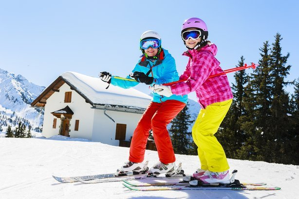 young skiers enjoying winter vacation
