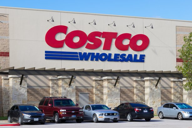 row of vehicles under the Costco Wholesale sign