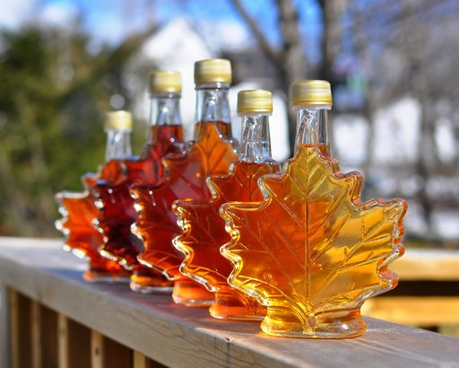 different color variations of maple syrup on porch outside