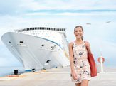 woman in dress by luxury cruise liner boat