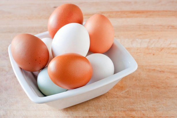 Bowl of white and brown eggs
