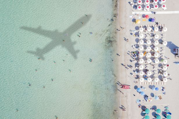 Airplane over beach in Italy