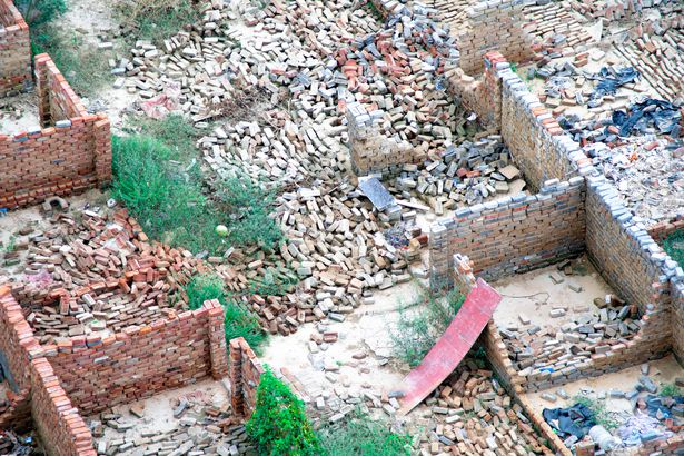 Demolished homes in India