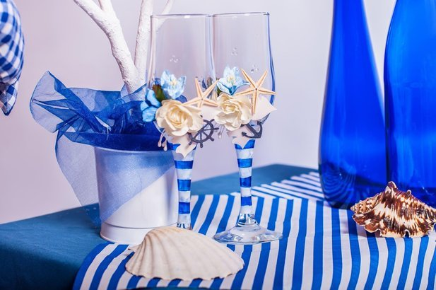 decoration on the marine theme with seashells, fish, bottles and glasses