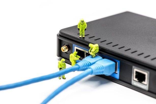 network engineers connecting cables to the network switch