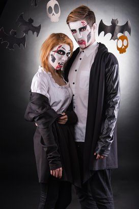 young couple celebrating halloween in costume