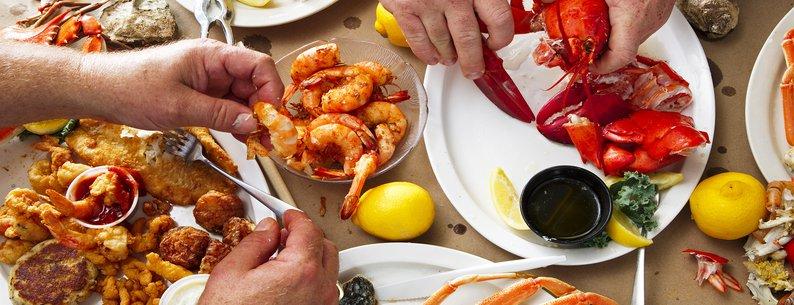 various platters of seafood dinner