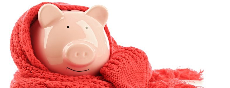 piggy bank wearing red scarf