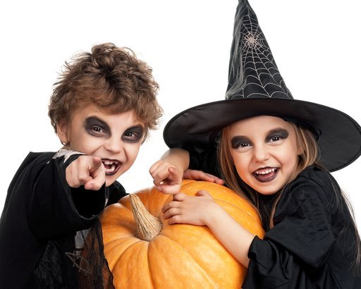 boy and girl wearing halloween costume with pumpkin