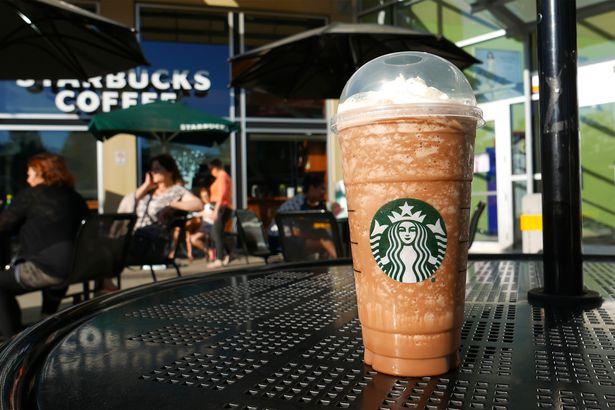 starbucks drink sitting on outdoor table