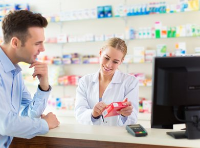 pharmacist and client at pharmacy counter