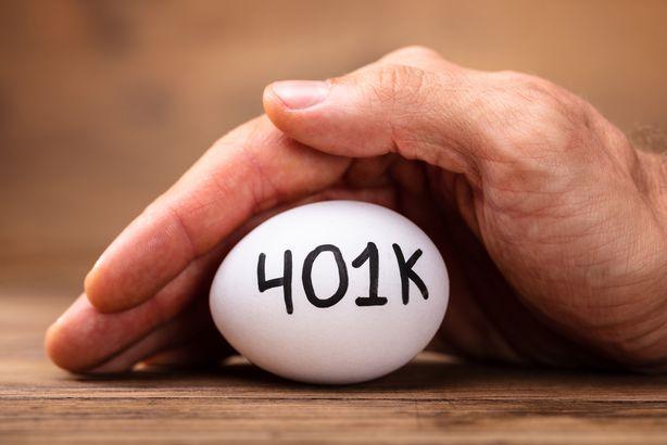 man protecting 401k white egg