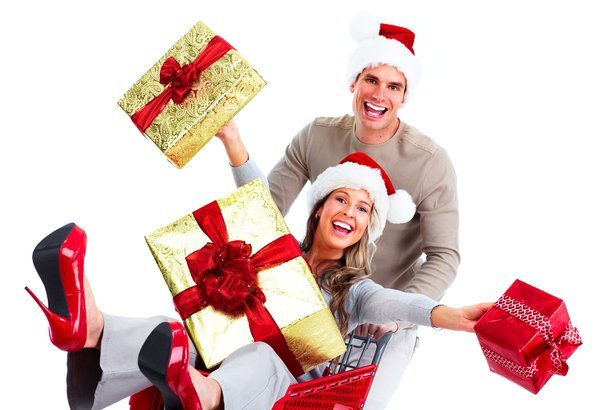 woman in shopping cart with man pushing it Christmas time