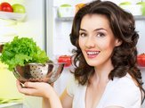 woman opens the fridge