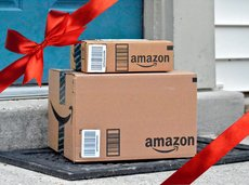 Amazon packages delivered to a home with a red ribbon overlay