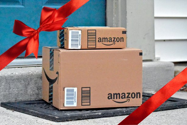 amazon packages delivered to a home with a red ribbon overlay - Amazon Christmas Gift