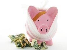 bandaged piggy bank with cash