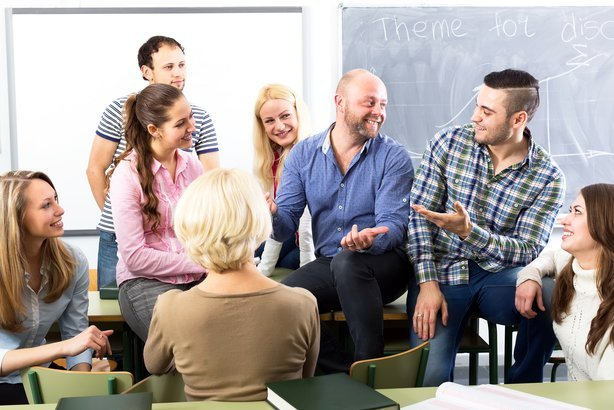 group of adult students having a conversation with each other