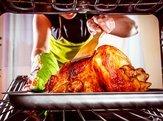housewife prepares roast chicken in the oven