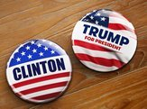 campaign buttons of Hillary Clinton and Donald Trump running for the president's office