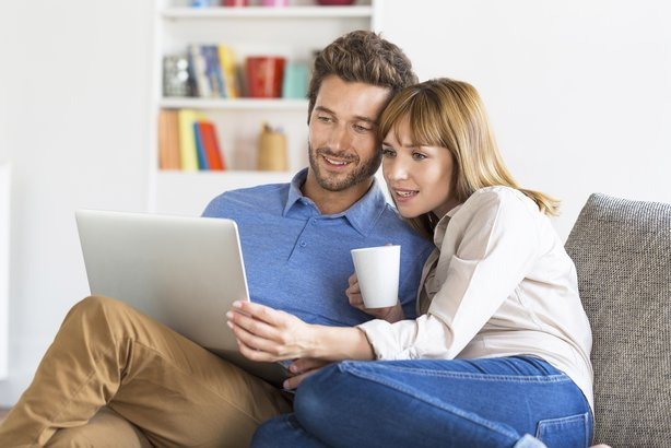 young couple surfing on internet with laptop