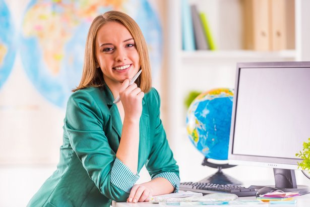 woman sitting in office travel agency