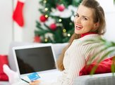smiling woman making Christmas shopping on internet