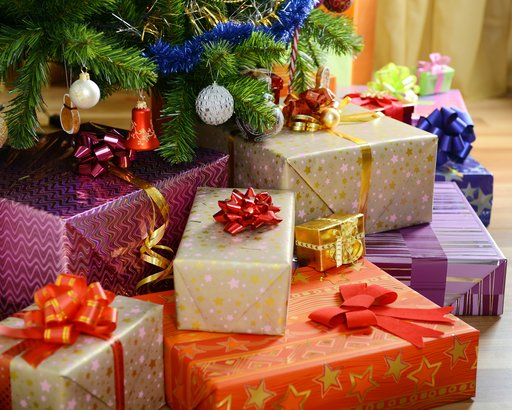 pile of gifts under Christmas tree
