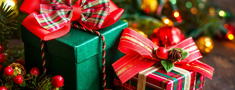 two Christmas gift boxes with decorations