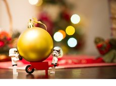 Star Wars Storm Trooper LEGOs holding a Christmas ornament