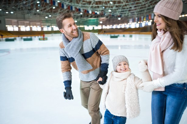smiling family ice skating