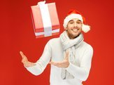 handsome man in christmas hat catching gift