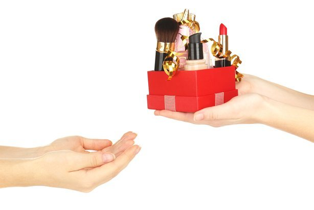 beauty set gift in hands giving to other hands