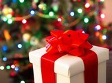 gift in front of Christmas tree