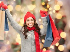 Happy woman holiday shopping and holding bags