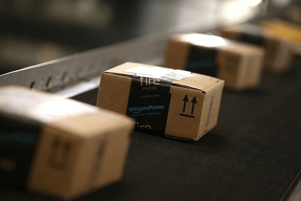 Boxes move along a conveyor belt at an Amazon fulfillment center