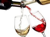red and white wine flow in two glasses