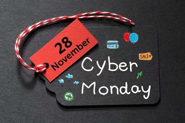 'Cyber Monday' text on a black tag with red and white twine
