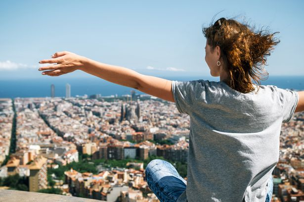 tourist enjoy of the view from above of Barcelona