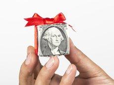 hand holding gift of dollar